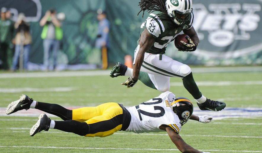 New York Jets running back Chris Ivory (33) jumps over Pittsburgh Steelers' William Gay (22) during the first half of an NFL football game Sunday, Nov. 9, 2014, in East Rutherford, N.J. (AP Photo/Bill Kostroun)