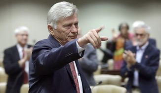 Arkansas Gov. Mike Beebe acknowledges legislators as he is applauded after speaking at a meeting of the Joint Budget Committee at the Arkansas state Capitol in Little Rock, Ark., Thursday, Nov. 13, 2014. (AP Photo/Danny Johnston)