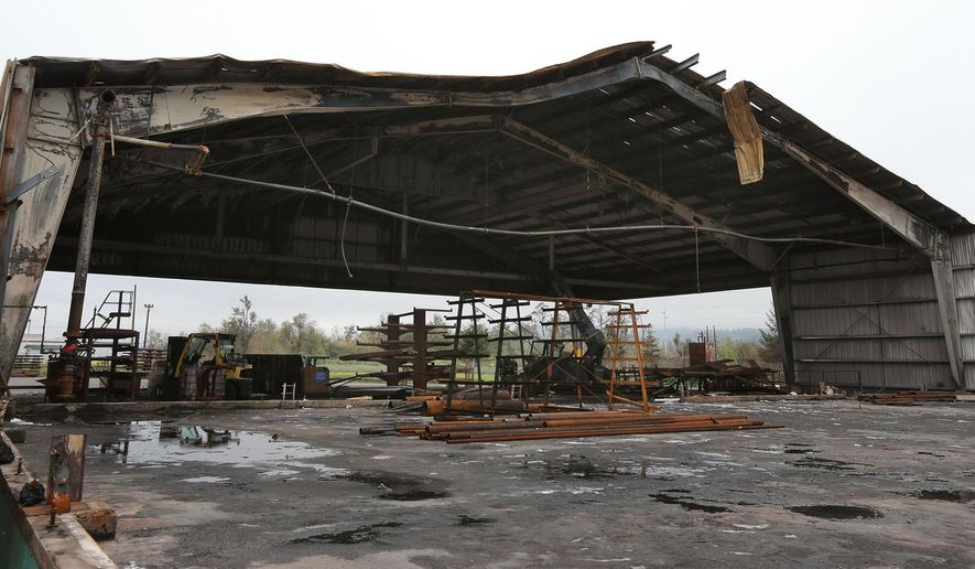 This photo taken on Nov. 7, 2014, shows the fire damaged Springfield Plywood Mill in Springfield, Ore.The mill owners are still considering whether to rebuild on the site. (AP Photo/The Register-Guard, Chris Pietsch)