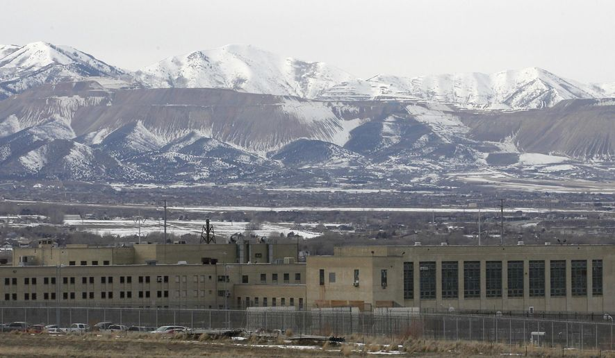 FILE - This Feb. 19, 2013 file photo shows the Utah State Prison in Draper, Utah. Utah's criminal and juvenile justice commission is releasing a package of proposals Wednesday, Nov. 12, 2014,  that aim to reduce costs and the population of the state prison system. (AP Photo/Rick Bowmer, File)