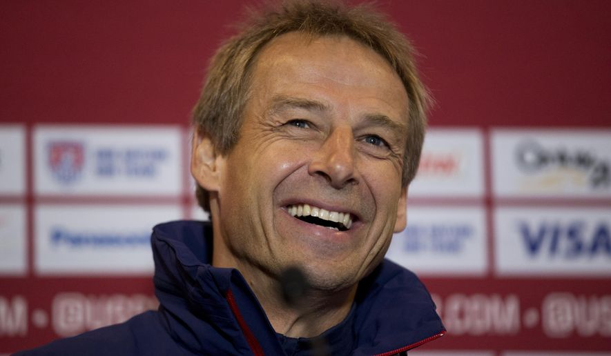 The U.S. national soccer team head coach Jurgen Klinsmann, from Germany, laughs during a press conference at Fulham's Craven Cottage stadium in London, Thursday, Nov. 13, 2014.  The U.S. are due to play Colombia in an international friendly soccer match at the stadium on Friday.  (AP Photo/Matt Dunham)