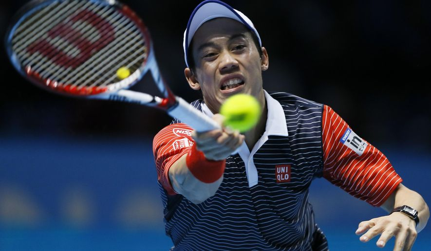 Japan's Kei Nishikori plays a return to Spain's David Ferrer during their ATP World Tour tennis finals match at the O2 arena in London, Thursday, Nov. 13, 2014. (AP Photo/Kirsty Wigglesworth)
