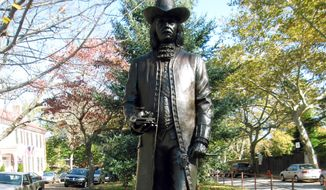 This Oct. 26, 2014 photo shows a statue of Englishman William Penn in Old New Castle, Delaware. (AP Photo/Beth J. Harpaz)