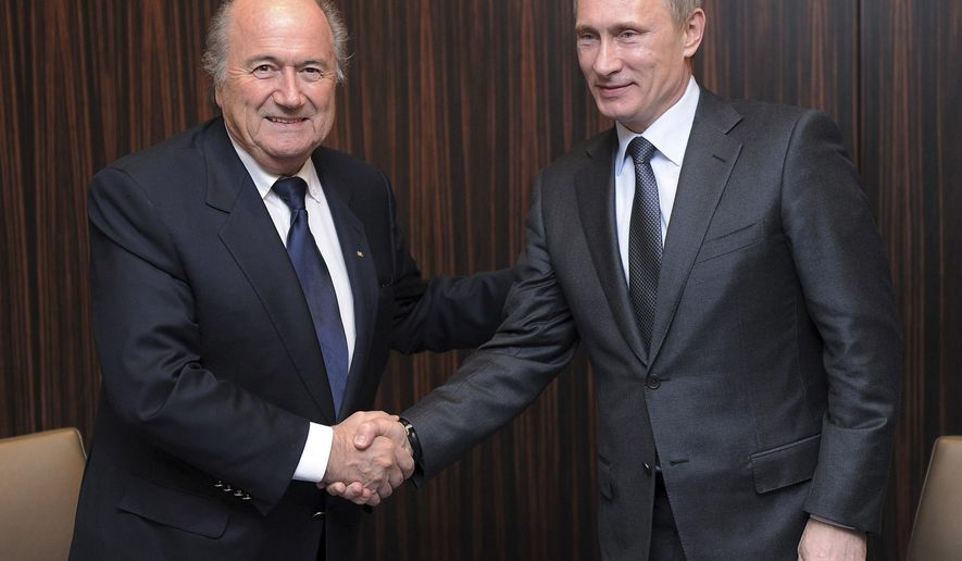 FILE - Russian Prime Minister Vladimir Putin, right, shakes hands with FIFA President Joseph Blatter after Russia was announced as the host for the 2018 soccer World Cup in Zurich, Switzerland. FIFA has cleared Russia and Qatar of any wrongdoing in their winning bids for the next two World Cups. (AP Photo/Kurt Schorrer, Pool)