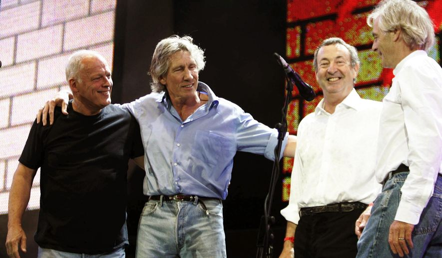 In this July 2, 2005, file photo, Pink Floyd's Dave Gilmore, left, Roger Waters, second left, Nick Mason, second right, and Rick Wright, appear on stage at the end of their set  at the Live 8 concert in Hyde Park,  London.  (AP Photo/Lefteris Pitarakis, File)