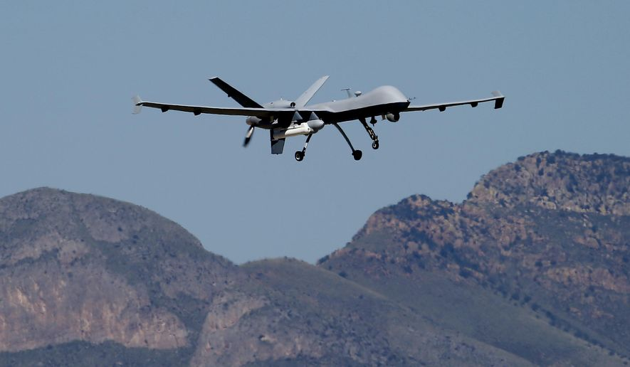 A U.S. Customs and Border Patrol drone aircraft lifts off, Wednesday, Sept 24, 2014 at Ft. Huachuca in Sierra Vista, Ariz. The U.S. government now patrols nearly half the Mexican border by drones alone in a largely unheralded shift to control desolate stretches where there are no agents, camera towers, ground sensors or fences, and it plans to expand the strategy to the Canadian border. It represents a significant departure from a decades-old approach that emphasizes boots on the ground and fences. (AP Photo/Matt York)