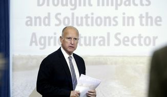 Gov. Jerry Brown enters a meeting of the Western Governors' Association where a panel met to discuss the drought that has gripped California for the last three years, at the Capitol in Sacramento, Calif., Thursday Nov. 13, 2014. (AP Photo/Rich Pedroncelli)