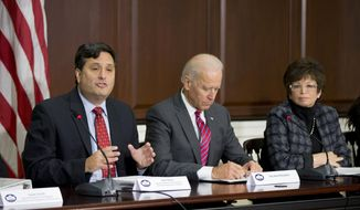 Ebola Response Coordinator Ron Klain, left, accompanied by Vice President Joe Biden, and White House Senior Adviser Valerie Jarrett, speaks during a meeting with faith and humanitarian groups as part of the administration's response to Ebola, Thursday, Nov. 13, 2014, in the Eisenhower Executive Office Building on the White House compound in Washington.    (AP Photo/Manuel Balce Ceneta)