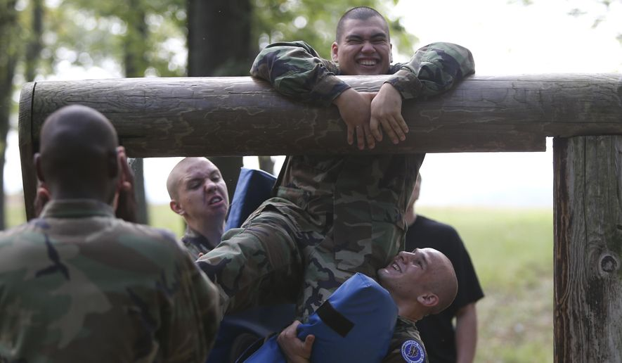ADVANCED FOR SUNDAY NOV. 16 AND THEREAFTER  Cadet Julio Rodriguez gets help from other cadets as he tries to get over an obstacle on the challenge course at Camp Atterbury, near Edinburgh, Ind., Oct. 2, 2014. The cadets from the Indiana National Guard's Hoosier ChalleNGe Academy spent two days on the course. The Academy, located in Rush County, takes troubled youth and provides them with a structured program aimed at turning their life around. (AP Photo/The Indianapolis Star, Mike Fender)