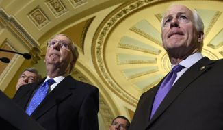 Senate Minority Leader Mitch McConnell of Ky., second from left, listens to a question from a reporter on Capitol Hill in Washington, Thursday, Nov. 13, 2014, after Senate Republicans voted on leadership positions for the 114th Congress. From left are, Sen. Roy Blunt, R-Mo., Sen. John Barrasso, R-Wyo., and Senate Minority Whip John Cornyn of Texas. (AP Photo/Susan Walsh)