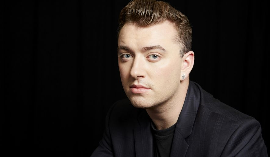 """FILE - In this Sept. 17, 2014 photo, British soul singer Sam Smith poses for a portrait in New York. Smith had a breakthrough year with his debut, """"In the Lonely Hour,"""" one of 2014's best-selling albums. It features the hits """"Stay With Me"""" and """"I'm Not the Only One."""" (Photo by Dan Hallman/Invision/AP, File)"""