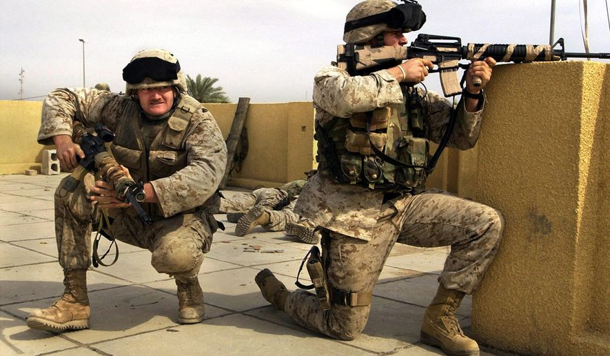 U.S. Marine snipers from the 2nd Battalion, 5th Marine Regiment, take cover during a gun battle with insurgents in Ramadi in Anbar province, Iraq, Oct. 31, 2004. (Associated Press) ** FILE **