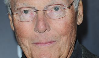 In this Nov. 17, 2012 file photo, Adam West arrives at Variety Power of Comedy at Avalon Hollywood in Los Angeles. (Photo by Richard Shotwell/Invision/AP, File)