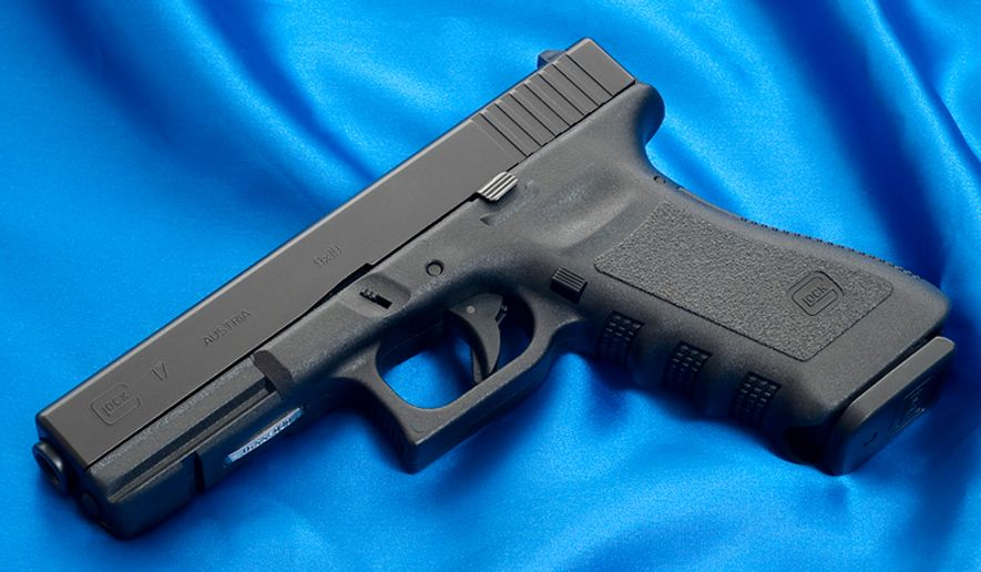 "GLOCK 17- A polymer-framed, short recoil operated, locked breech semi-automatic pistols designed and produced by Glock Ges.m.b.H., located in Deutsch-Wagram, Austria. It entered Austrian military and police service by 1982. Despite initial resistance from the market to accept a ""plastic gun"" due to durability and reliability concerns, and fears that the pistol would be ""invisible"" to metal detectors in airports, Glock pistols have become the company's most profitable line of products, commanding 65% of the market share of handguns for United States law enforcement agencies as well as supplying numerous national armed forces and security agencies worldwide. Glocks are also popular firearms amongst civilians for recreational/competition shooting, home/self defense and concealed/open carry."