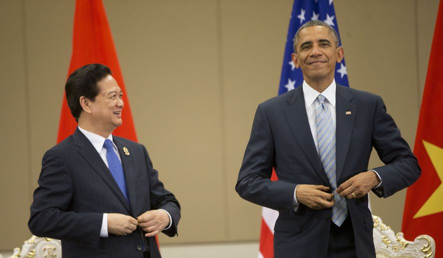 U.S. President Barack Obama, right, and Vietnam's Prime Minister Nguyen Tan Dung, adjust their suit jackets during their bilateral meeting at the Myanmar International Convention Center, Thursday, Nov. 13, 2014, in Naypyitaw, Myanmar. (AP Photo/Pablo Martinez Monsivais)