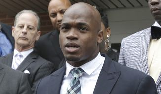 FILE - In this Nov. 4, 2014, file photo, Minnesota Vikings running back Adrian Peterson speaks to the media after pleading no contest to an assault charge in Conroe, Texas. Peterson will meet with the NFL on Monday, Nov. 17, 2014,  about possible reinstatement with the Vikings. A person with knowledge of the hearing told The Associated Press on Thursday, Nov. 13, that the hearing will be at 2 p.m. EST. The person spoke on condition of anonymity because the hearing has not been announced. (AP Photo/Pat Sullivan, File)