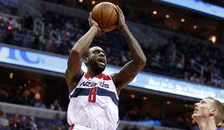 Washington Wizards forward Rasual Butler (8) shoots the ball in the second half of an NBA basketball game against the Detroit Pistons, Wednesday, Nov. 12, 2014 in Washington. The Wizards won 107-103. (AP Photo/Alex Brandon)