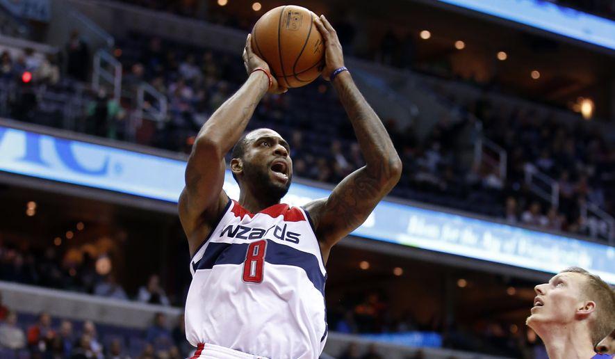 Washington Wizards forward Rasual Butler (8) shoots the ball in the second half of an NBA basketball game against the Detroit Pistons, Wednesday, Nov. 12, 2014 in Washington. The Wizards won 107-103. (AP Photo/Alex Brandon)