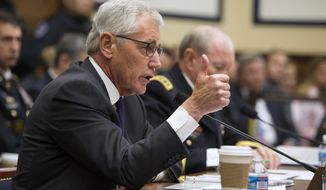 Defense Secretary Chuck Hagel, left, accompanied by Joint Chiefs Chairman Gen. Martin Dempsey testifies on Capitol Hill in Washington, Thursday, Nov. 13, 2014, before the House Armed Services committee hearing on the Islamic State group.  (AP Photo/Evan Vucci)