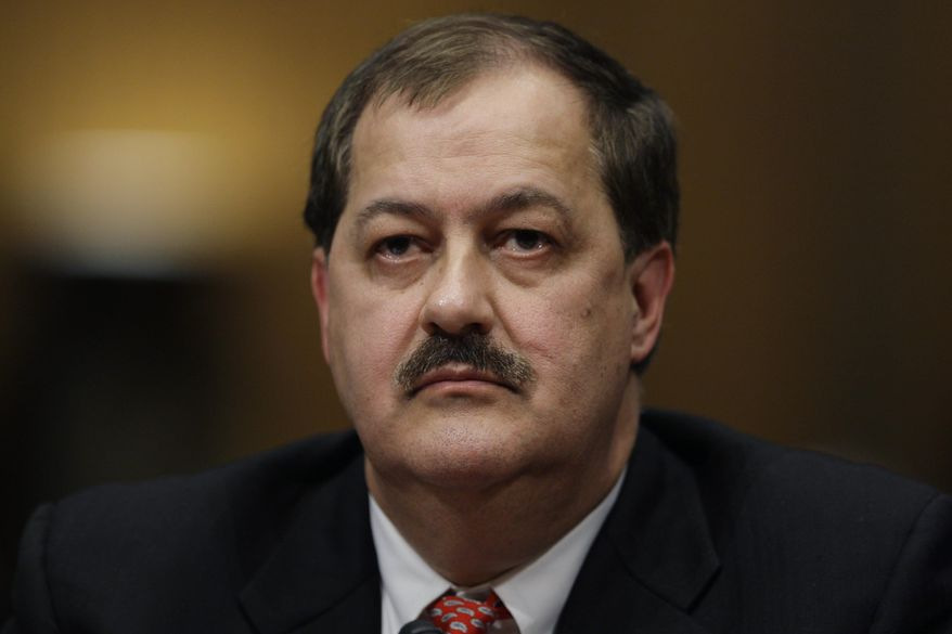 FILE - In this May 20, 2010 photo, Massey Energy Company Chief Executive Officer Don Blankenship pauses as he testifies on Capitol Hill in Washington. The former CEO who oversaw the West Virginia mine that exploded in 2010, killing 29 people, has been indicted on federal charges related to a mine safety investigation. U.S. Attorney Booth Goodwin said a federal grand jury indicted Blankenship on Thursday, Nov. 13, 2014. (AP Photo/Carolyn Kaster, File)