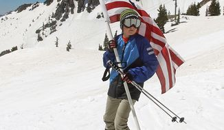 FILE - In this May 26, 2014, file photo, Carter Budge, 11, of Sandy, Utah, skis with a flag during the Snowbird Ski Resort's final day of skiing and riding for the 2013/14 winter season, in Little Cottonwood Canyon in the Wasatch Range, outside of Salt Lake City. A Colorado ski resort is settling a legal fight with Salt Lake City over winter sports marketing slogans. Steamboat Ski Resort sued in October, claiming a $1.8 million Utah advertising campaign violated its trademark on the name Ski Town, U.S.A. (AP Photo/Rick Bowmer, File)