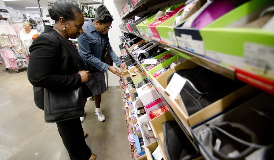 Customers shop at the Century 21 department store in Philadelphia. Retailers are enjoying increased pre-holiday sales. (Associated Press)