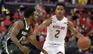Maryland guard Melo Trimble (2) dribbles against Wagner guard JoJo Cooper (5) during the second half of an NCAA college basketball game, Friday, Nov. 14, 2014, in College Park, Md. Maryland won 82-48. (AP Photo/Nick Wass)