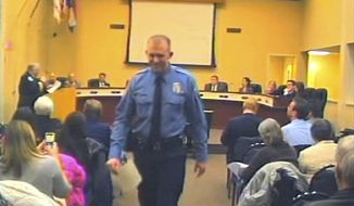 FILE - In this  Feb. 11, 2014 file image from video provided by the City of Ferguson, Mo., officer Darren Wilson attends a city council meeting in Ferguson. Police identified Wilson, 28, as the police officer who shot 18-year-old Michael Brown on Aug. 9, 2014 in Ferguson. Police departments across the country are bracing for large demonstrations when a grand jury decides whether to indict Wilson. (AP Photo/City of Ferguson, File)