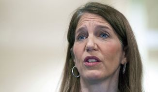 Health and Human Services Secretary Sylvia Burwell answers a reporters question following her tour of the Greater Prince William Community Health Center, Evergreen Terrace Site, in Manassas, Va., Saturday, Nov. 15, 2014. (AP Photo/Cliff Owen)