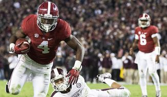 Alabama running back T.J. Yeldon (4) runs in to score a touchdown against Mississippi State defensive back Justin Cox (9) during the second half of an NCAA college football game Saturday, Nov. 15, 2014, in Tuscaloosa, Ala. Alabama won 25-20. (AP Photo/Brynn Anderson)
