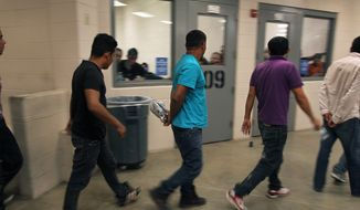 Immigrants who have been caught crossing the border illegally are housed inside the McAllen Border Patrol Station in McAllen, Texas, where they are processed on Tuesday, July 15, 2014. (AP Photo/Los Angeles Times, Rick Loomis, Pool) ** FILE **
