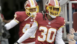 Washington Redskins free safety E.J. Biggers (30) runs onto the field before an NFL football game against the Tampa Bay Buccaneers in Landover, Md., Sunday, Nov. 16, 2014. (AP Photo/Patrick Semansky)