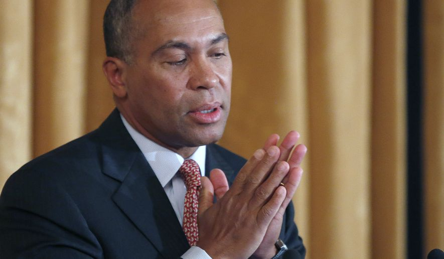 In this March 24, 2014 file photo, Massachusetts Gov. Deval Patrick reacts as he speaks at a leadership forum in Boston. The state that served as a template for President Barack Obama's Affordable Care Act had significant trouble coordinating with the federal government. The Massachusetts state-run health insurance website, designed by the same contractor that worked on the troubled federal website, performed so poorly that it prompted a public apology from Gov. Patrick. (AP Photo/Elise Amendola, File)