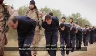 This still image taken from an undated video published on the Internet by the Islamic State group militants and made available, Sunday, Nov. 16, 2014, purports to show extremists marching Syrian soldiers before beheading them. The high-definition video later shows the beheadings of about a dozen men identified as Syrian military officers and pilots, all dressed in blue jumpsuits. The Associated Press could not independently verify the footage, though it appeared on websites used in the past by the Islamic State group, which now controls a third of Syria and Iraq. (AP Photo)