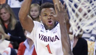 Virginia guard Justin Anderson (1) shoots over Norfolk State guard D'Shon Taylor (4) during an NCAA college basketball game, Sunday Nov. 16, 2014 in Charlottesville, Va. (AP Photo/Andrew Shurtleff)