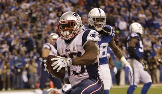 New England Patriots running back Jonas Gray celebrates his touchdown against the Indianapolis Colts during the second half of an NFL football game in Indianapolis, Sunday, Nov. 16, 2014. (AP Photo/AJ Mast)
