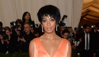 "This May 5, 2014, file photo shows Solange Knowles, sister of Beyonce Knowles, at The Metropolitan Museum of Art's Costume Institute benefit gala celebrating ""Charles James: Beyond Fashion"" in New York. The 28-year-old singer (and sister of Beyonce) wed video director Alan Ferguson, 51, over the weekend, her publicist confirmed on Sunday, Nov. 16, 2014. (Photo by Evan Agostini/Invision/AP, File)"