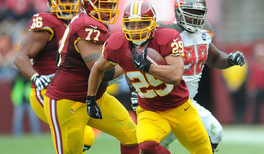 Washington Redskins running back Roy Helu (29) turns upfield on his way to the endzone for a 30-yard touchdown reception in the second quarter against the Tampa Bay Buccaneers at FedExField, Landover, Md., Oct. 6, 2014. (Preston Keres/Special for The Washington Times)