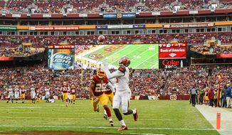Tampa Bay Buccaneers wide receiver Mike Evans (13) catches a 36 yard touchdown pass to go up 19-7 in the third quarter as the Washington Redskins play the Tampa Bay Buccaneers in NFL football at FedExField, Landover, Md., Sunday, November 16, 2014. (Andrew Harnik/The Washington Times)