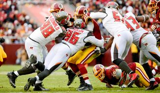 Robert Griffin III is sacked in the fourth quarter as the Washington Redskins play the Tampa Bay Buccaneers in NFL football at FedExField, Landover, Md., Sunday, November 16, 2014. (Andrew Harnik/The Washington Times)