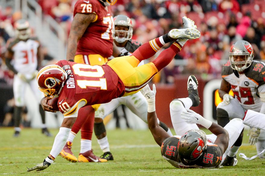 Washington Redskins quarterback Robert Griffin III (10) is sacked in the fourth quarter as the Washington Redskins play the Tampa Bay Buccaneers in NFL football at FedExField, Landover, Md., Sunday, November 16, 2014. (Andrew Harnik/The Washington Times)