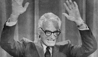 Barry Goldwater, the GOP presidential candidate four years ago, waves to the delegates and spectator during his speech to this year's Republican National Convention in Miami Beach August 5, 1968. (AP Photo)