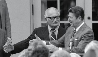 President Ronald Reagan, right, greets Sen. Barry Goldwater, R-Ariz., in the Rose Garden at the White House during a ceremony to start National Partiotism Week in Washington, D.C., Tuesday, Feb. 17, 1981.  (AP Photo/Charles Tasnadi)