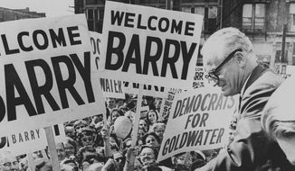 Barry Goldwater greets an Indianapolis crowd during a campaign tour in Oct. 1964. (AP Photo