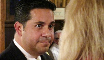 Rep. Ben Ray Lujan, New Mexico Democrat, listens to a voter before a candidate forum on Oct. 5, 2010, in Los Alamos, N.M. (Associated Press) ** FILE **
