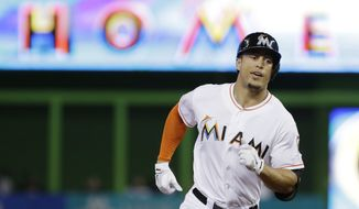 Miami Marlins' Giancarlo Stanton rounds second base after hitting a home run during the first inning of a baseball game against the New York Mets, Monday, Sept. 1, 2014 in Miami. (AP Photo/Wilfredo Lee)