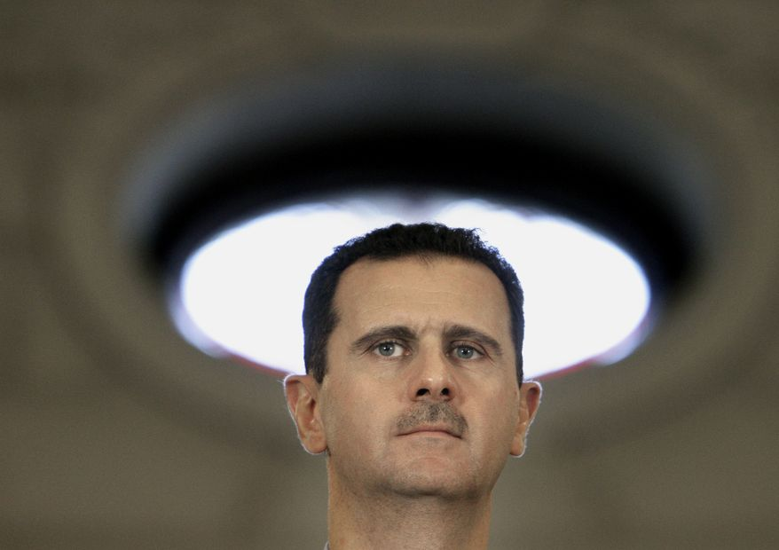 Syrian President Bashar Assad presents a snag in U.S.-Iran nuclear arms talks. (AP Photo/Vadim Ghirda)