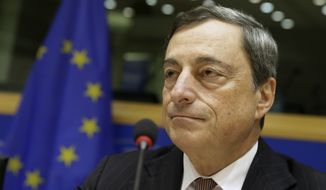 President of the European Central Bank Mario Draghi addresses the Committee on Economic and Monetary Affairs, at the European Parliament building, in Brussels on Monday, Nov. 17, 2014. (AP Photo/Yves Logghe)