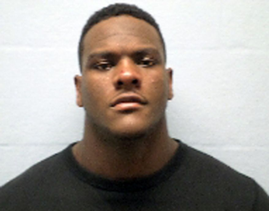 This photo released by the Erie County sheriff's department in Sandusky, Ohio, shows Frank Clark, 21, of Ypsilanti, Mich. The University of Michigan defensive end is being held without bond Sunday, Nov. 16, 2014, in the Erie County jail in Sandusky, Ohio after he was arrested Saturday on a domestic violence charge. (AP Photo/Erie County Sheriff)
