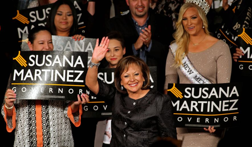 New Mexico Gov. Susana Martinez waves to her supporters upon her arrival to the victory party on election night in Albuquerque, N.M., Tuesday, Nov. 4, 2014. Republican Susana Martinez was re-elected beating Democratic challenger Gary King. (AP Photo/Andres Leighton)